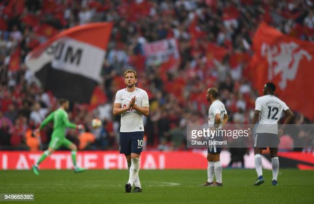 Harry Kane of Tottenham Hotspur acknowledges the crowd at the end of The Emirates FA Cup Semi Final match between Manchester United and Tottenham...