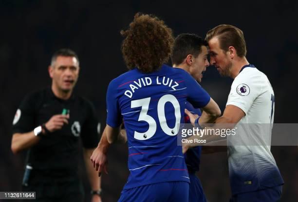 Harry Kane of Tottenham Hotspur and Cesar Azpilicueta of Chelsea as David Luiz of Chelsea intervenes during the Premier League match between Chelsea...