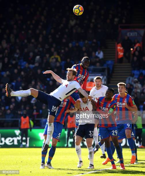 Harry Kane of Tottenham Hotspur and Christian Benteke of Crystal Palace compete for the ball during the Premier League match between Crystal Palace...