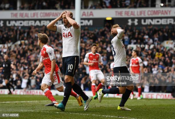Harry Kane of Tottenham Hotspur and Christian Eriksen of Tottenham Hotspur react during the Premier League match between Tottenham Hotspur and...