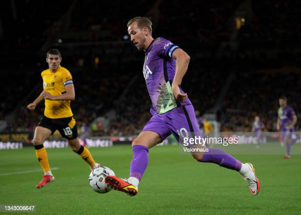 Harry Kane of Tottenham Hotspur and Conor Coady of Wolverhampton Wanderers in action during the Carabao Cup Third Round match between Wolverhampton...