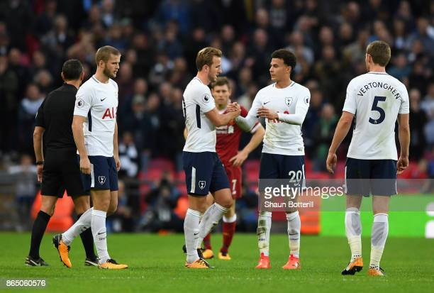 Harry Kane of Tottenham Hotspur and Dele Alli of Tottenham Hotspur shake hands as he is forced off through injury during the Premier League match...