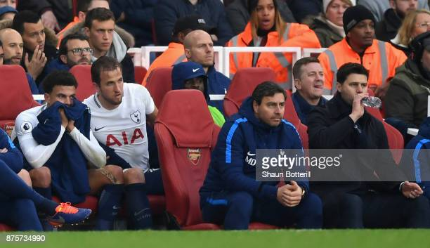Harry Kane of Tottenham Hotspur and Dele Alli of Tottenham Hotspur are substituted during the Premier League match between Arsenal and Tottenham...