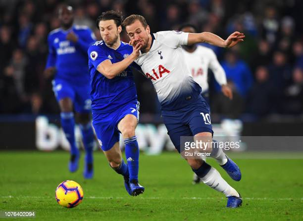 Harry Kane of Tottenham Hotspur and Harry Arter of Cardiff City battle for the ball during the Premier League match between Cardiff City and...