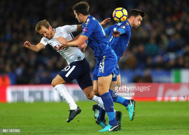 Harry Kane of Tottenham Hotspur and Harry Maguire and Ben Chilwell of Leicester City during the Premier League match between Leicester City and...