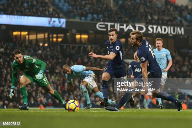 Harry Kane of Tottenham Hotspur and Harry Winks of Tottenham Hotspur during the Premier League match between Manchester City and Tottenham Hotspur at...
