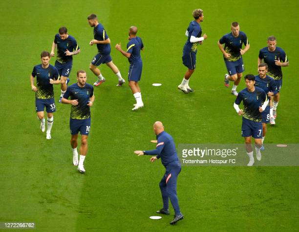 Harry Kane of Tottenham Hotspur and his team mates warm up prior to the Premier League match between Tottenham Hotspur and Everton at Tottenham...