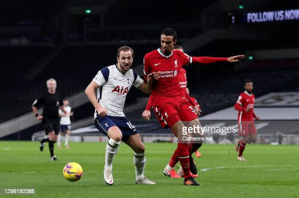 Harry Kane of Tottenham Hotspur and Joel Matip of Liverpool battle for possession during the Premier League match between Tottenham Hotspur and...