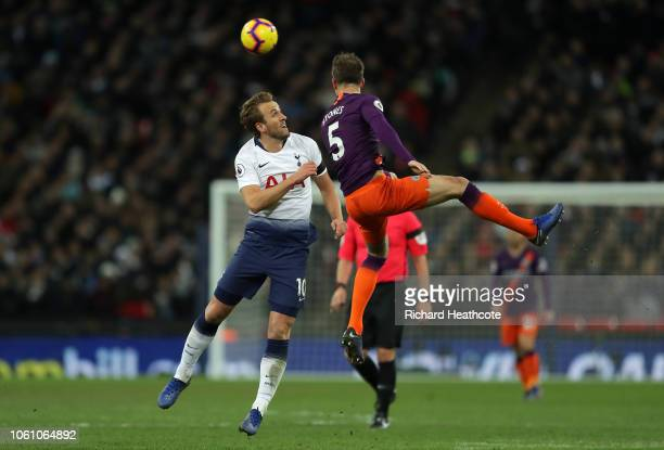 Harry Kane of Tottenham Hotspur and John Stones of Man City battle for the ball during the Premier League match between Tottenham Hotspur and...