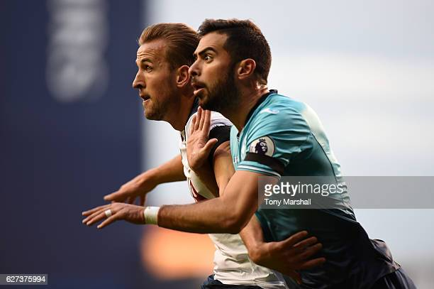 Harry Kane of Tottenham Hotspur and Jordi Amat of Swansea City tussle during the Premier League match between Tottenham Hotspur and Swansea City at...