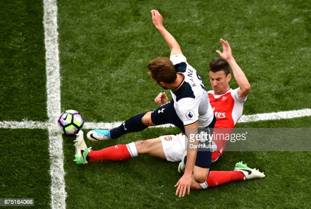 Harry Kane of Tottenham Hotspur and Laurent Koscielny of Arsenal compete for the ball during the Premier League match between Tottenham Hotspur and...