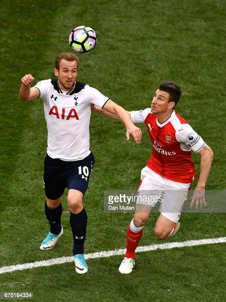 Harry Kane of Tottenham Hotspur and Laurent Koscielny of Arsenal battle for possession during the Premier League match between Tottenham Hotspur and...