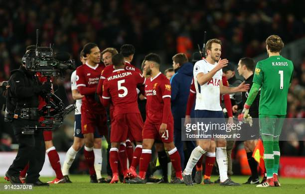 Harry Kane of Tottenham Hotspur and Loris Karius of Liverpool shake hands after the Premier League match between Liverpool and Tottenham Hotspur at...