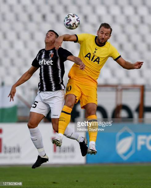 Harry Kane of Tottenham Hotspur and Lucas Masoero of Lokomotiv Plovdiv compete for a header during the UEFA Europa League second qualifying round...
