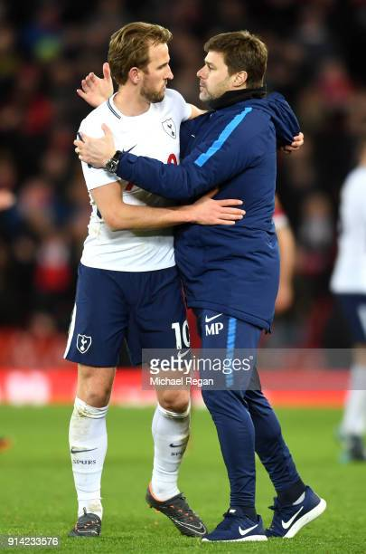Harry Kane of Tottenham Hotspur and Mauricio Pochettino Manager of Tottenham Hotspur celebrate vicotry after the Premier League match between...
