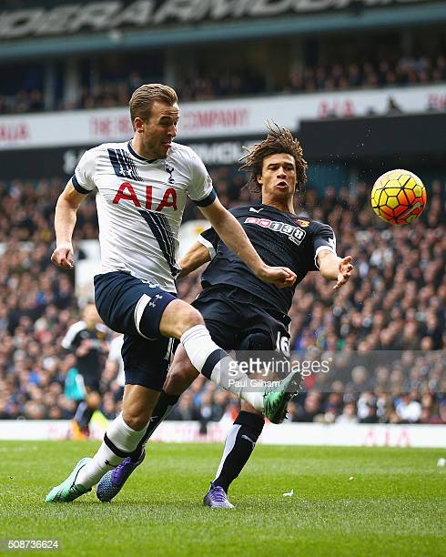 Harry Kane of Tottenham Hotspur and Nathan Ake of Watford compete for the ball during the Barclays Premier League match between Tottenham Hotspur and...