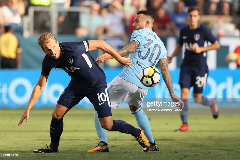 Harry Kane of Tottenham Hotspur and Nicolas Otamendi of Manchester City during the International Champions Cup 2017 match between Manchester City and Tottenham Hotspur at Nissan Stadium on July 29, 2017 in Nashville, Tennessee.