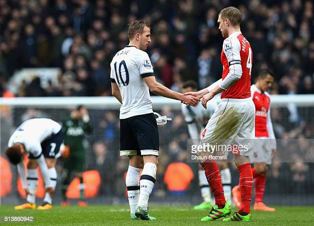 Harry Kane of Tottenham Hotspur and Per Mertesacker of Arsenal shake hands after their 22 draw in the Barclays Premier League match between Tottenham...