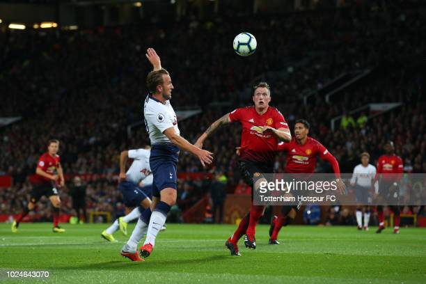 Harry Kane of Tottenham Hotspur and Phil Jones of Manchester United in action during the Premier League match between Manchester United and Tottenham...