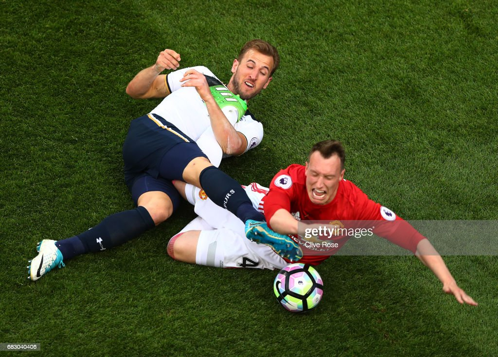 Harry Kane of Tottenham Hotspur and Phil Jones of Manchester United battle for possession during the Premier League match between Tottenham Hotspur and Manchester United at White Hart Lane on May 14, 2017 in London, England. Tottenham Hotspur are playing their last ever home match at White Hart Lane after their 112 year stay at the stadium. Spurs will play at Wembley Stadium next season with a move to a newly built stadium for the 2018-19 campaign.