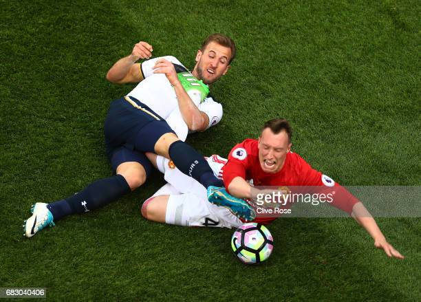 Harry Kane of Tottenham Hotspur and Phil Jones of Manchester United battle for possession during the Premier League match between Tottenham Hotspur...