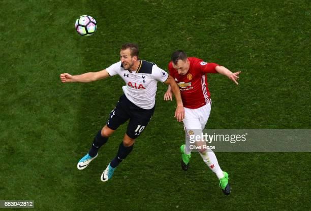 Harry Kane of Tottenham Hotspur and Phil Jones of Manchester United battle to win a header during the Premier League match between Tottenham Hotspur...