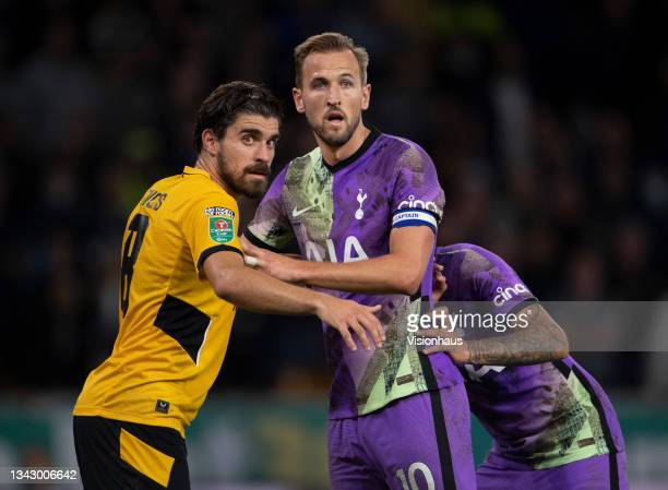 Harry Kane of Tottenham Hotspur and Ruben Neves of Wolverhampton Wanderers wait for a corner during the Carabao Cup Third Round match between...