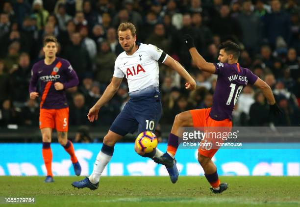 Harry Kane of Tottenham Hotspur and Sergio Aguero of Manchester City compete for the ball during the Premier League match between Tottenham Hotspur...