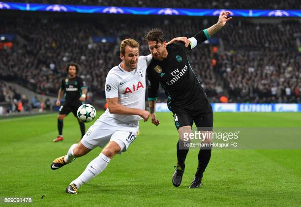 Harry Kane of Tottenham Hotspur and Sergio Ramos of Real Madrid battle for the ball during the UEFA Champions League group H match between Tottenham...