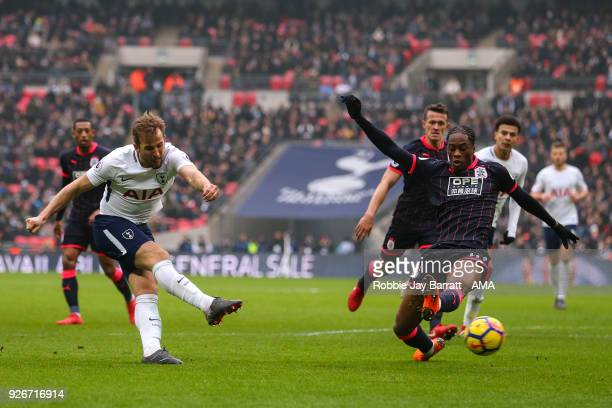 Harry Kane of Tottenham Hotspur and Terence Kongolo of Huddersfield Town during the Premier League match between Tottenham Hotspur and Huddersfield...