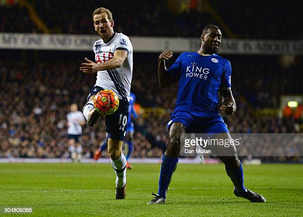 Harry Kane of Tottenham Hotspur and Wes Morgan of Leicester City compete for the ball during the Barclays Premier League match between Tottenham...