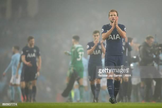 Harry Kane of Tottenham Hotspur applauds the fans during the Premier League match between Manchester City and Tottenham Hotspur at Etihad Stadium on...