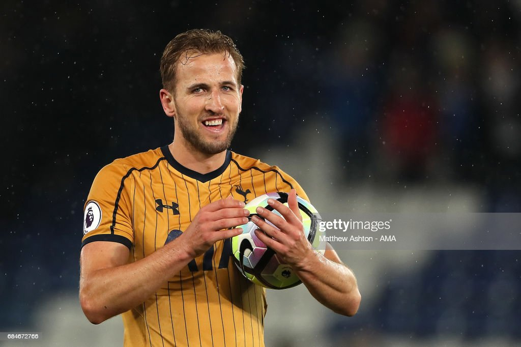 Harry Kane of Tottenham Hotspur applauds the fans with the match ball after his four goals at the end of the Premier League match between Leicester City and Tottenham Hotspur at The King Power Stadium on May 18, 2017 in Leicester, England.