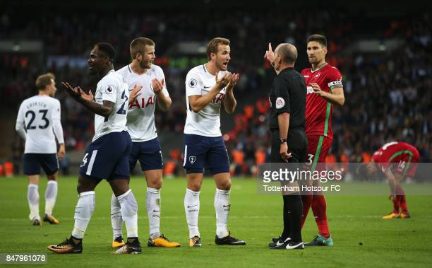 Harry Kane of Tottenham Hotspur argues with referee Mike Dean during the Premier League match between Tottenham Hotspur and Swansea City at Wembley...