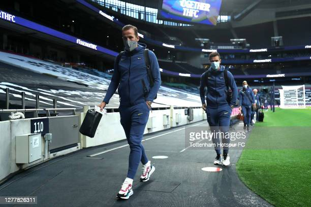 Harry Kane of Tottenham Hotspur arrives at the stadium with Giovani Lo Celso of Tottenham Hotspur prior to during the UEFA Europa League playoff...