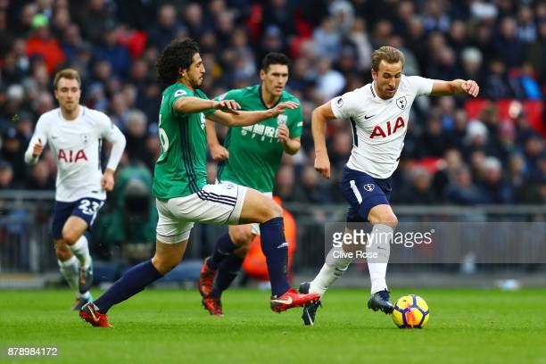 Harry Kane of Tottenham Hotspur attempts to get away from Ahmed ElSayed Hegazi of West Bromwich Albion during the Premier League match between...