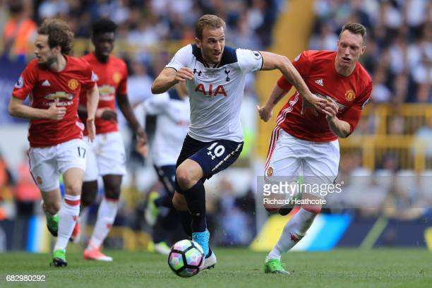 Harry Kane of Tottenham Hotspur attempts to get away from Phil Jones of Manchester United during the Premier League match between Tottenham Hotspur...