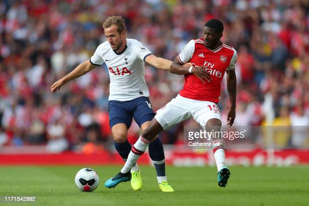 Harry Kane of Tottenham Hotspur battles for possession with Ainsley MaitlandNiles of Arsenal during the Premier League match between Arsenal FC and...
