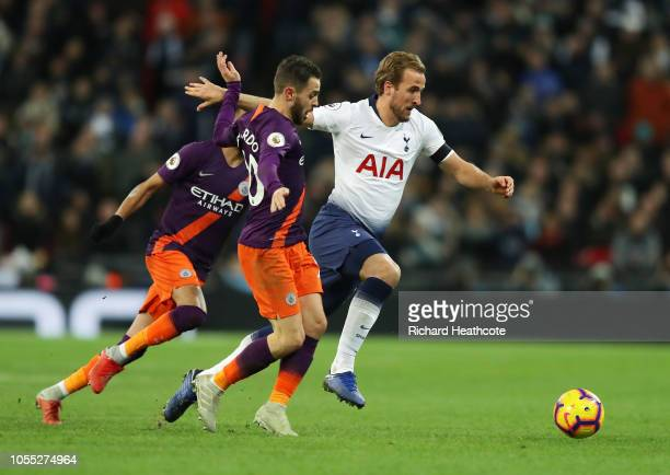 Harry Kane of Tottenham Hotspur battles for possession with Bernardo Silva of Manchester City during the Premier League match between Tottenham...