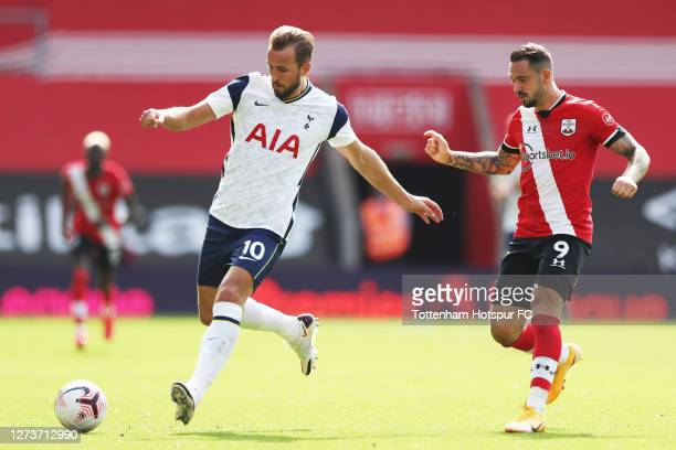 Harry Kane of Tottenham Hotspur battles for possession with Danny Ings of Southampton during the Premier League match between Southampton and...