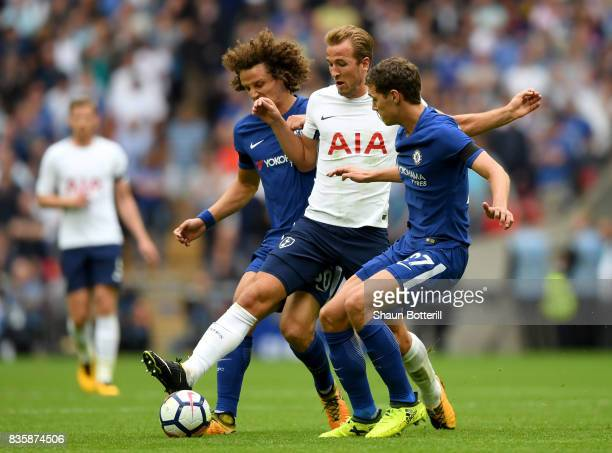 Harry Kane of Tottenham Hotspur battles for possession with David Luiz of Chelsea and Andreas Christensen of Chelsea during the Premier League match...