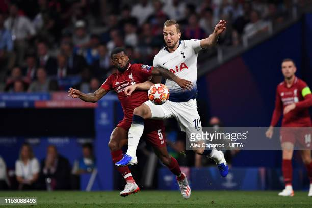 Harry Kane of Tottenham Hotspur battles for possession with Georginio Wijnaldum of Liverpool during the UEFA Champions League Final between Tottenham...
