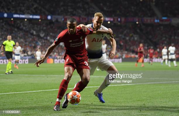 Harry Kane of Tottenham Hotspur battles for possession with Joel Matip of Liverpool during the UEFA Champions League Final between Tottenham Hotspur...