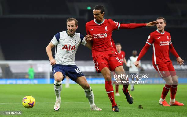 Harry Kane of Tottenham Hotspur battles for possession with Joel Matip of Liverpool during the Premier League match between Tottenham Hotspur and...