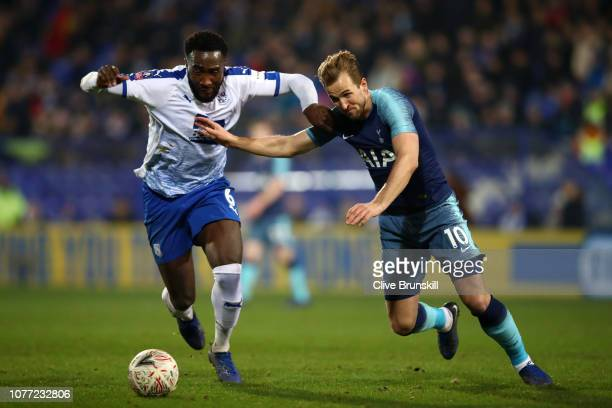Harry Kane of Tottenham Hotspur battles for possession with Manny Monthe of Tranmere Rovers during the FA Cup Third Round match between Tranmere...