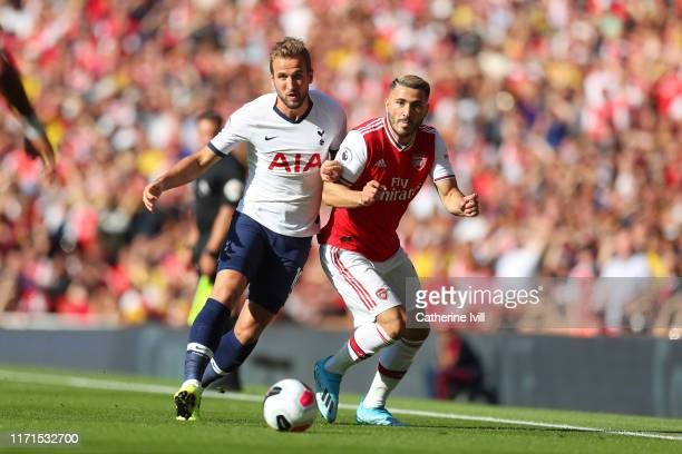 Harry Kane of Tottenham Hotspur battles for possession with Sead Kolasinac of Arsenal during the Premier League match between Arsenal FC and...