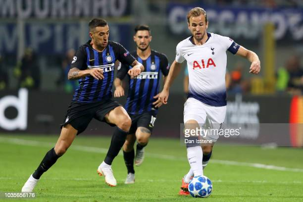 Harry Kane of Tottenham Hotspur battles for the ball with Matias Vecino of Internazionale during the Group B match of the UEFA Champions League...