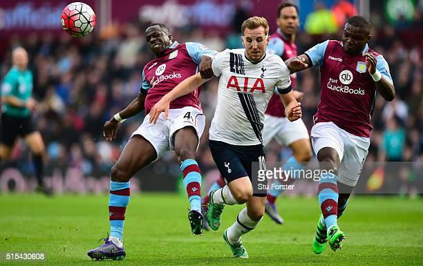 Harry Kane of Tottenham Hotspur battles with Aly Cissokho of Aston Villa during the Barclays Premier League match between Aston Villa and Tottenham...