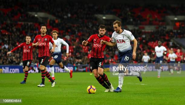 Harry Kane of Tottenham Hotspur battles with Jack Stephens of Southampton during the Premier League match between Tottenham Hotspur and Southampton...