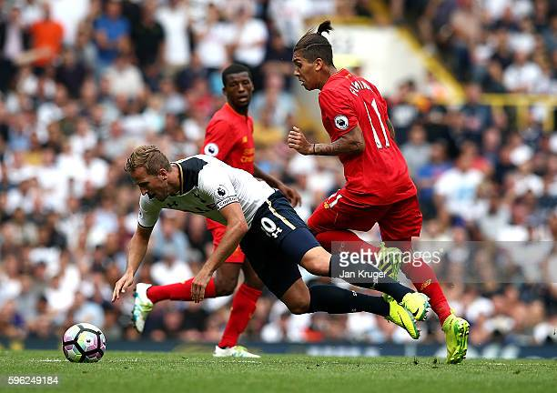 Harry Kane of Tottenham Hotspur battles with Roberto Firmino of Liverpool during the Premier League match between Tottenham Hotspur and Liverpool at...